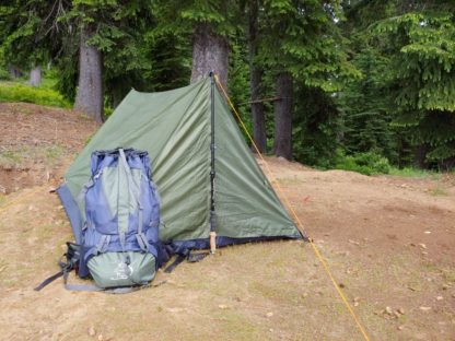 backpack and trekking pole tent