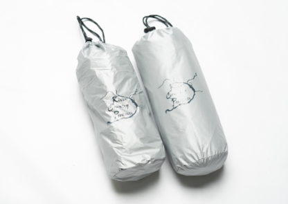 silver pillow and pad in bags